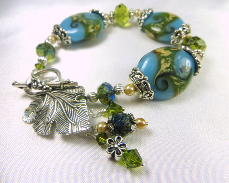 Lampwork Glass Bracelet in Seascape Teal and Olive Green with Silver Leaf Toggle - Odyssey Creations