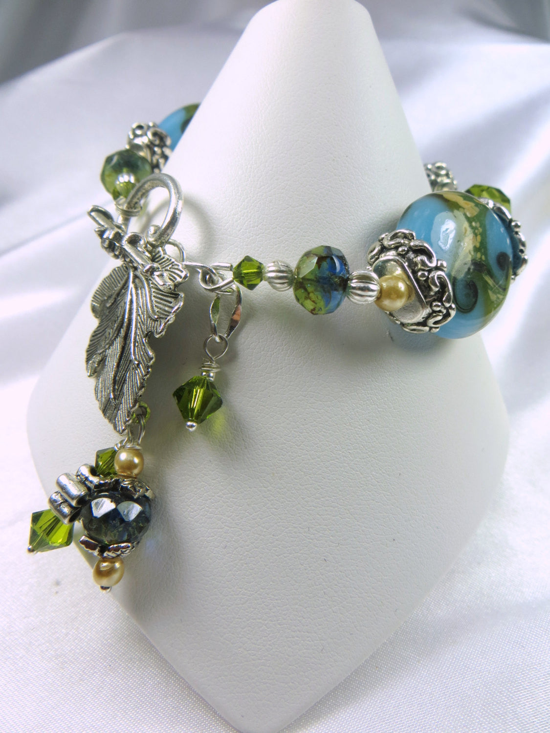 Lampwork Glass Bracelet in Seascape Teal and Olive Green with silver leaf toggle clasp with charms - Odyssey Creations