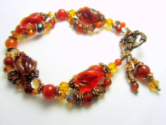 Bracelet in Rust Orange Vintage Lampwork and Bali Antique Copper Vintage Style with Carnelian Semiprecious Faceted Stones - Odyssey Creations