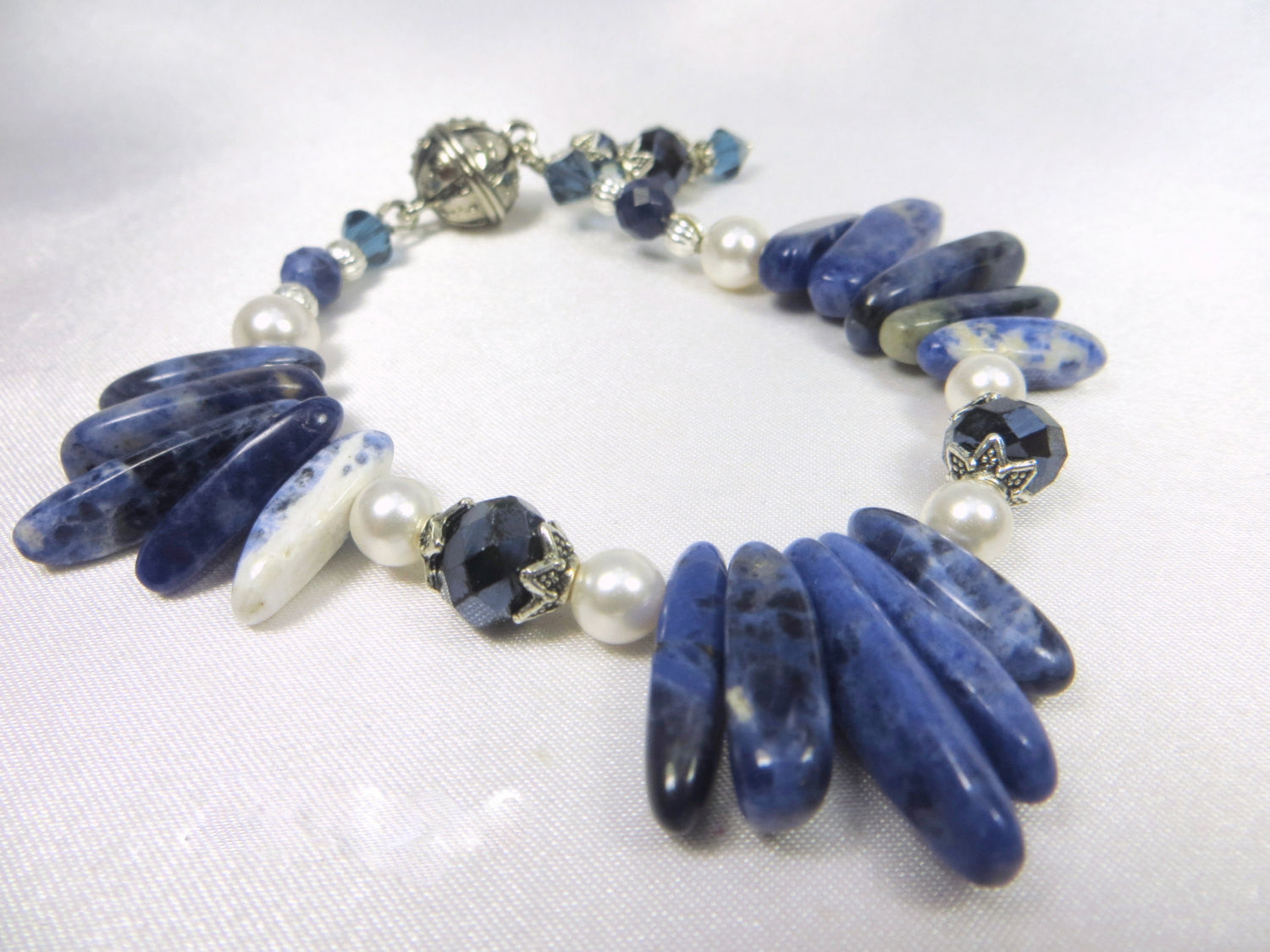 Blue Sodalite Bracelet in Daggers,Swarovski Crystals and White Pearls with Charms and magnetic clasp - Odyssey Creations