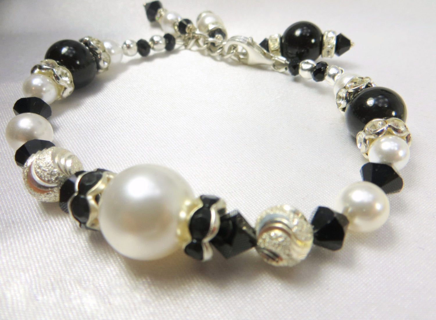 Black and White Bracelet with Swarovski Pearls, Onyx Stones, Diamond Cut Sterling Silver Beads and Crystal Rondelles - Odyssey Creations