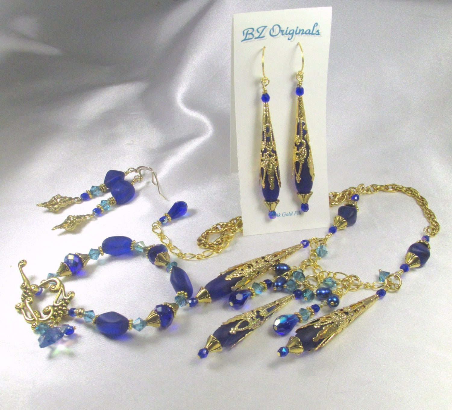 Sea Glass Cobalt Blue and Turquoise Swarovski Crystal Earrings with Gold Concho Shells - Odyssey Creations