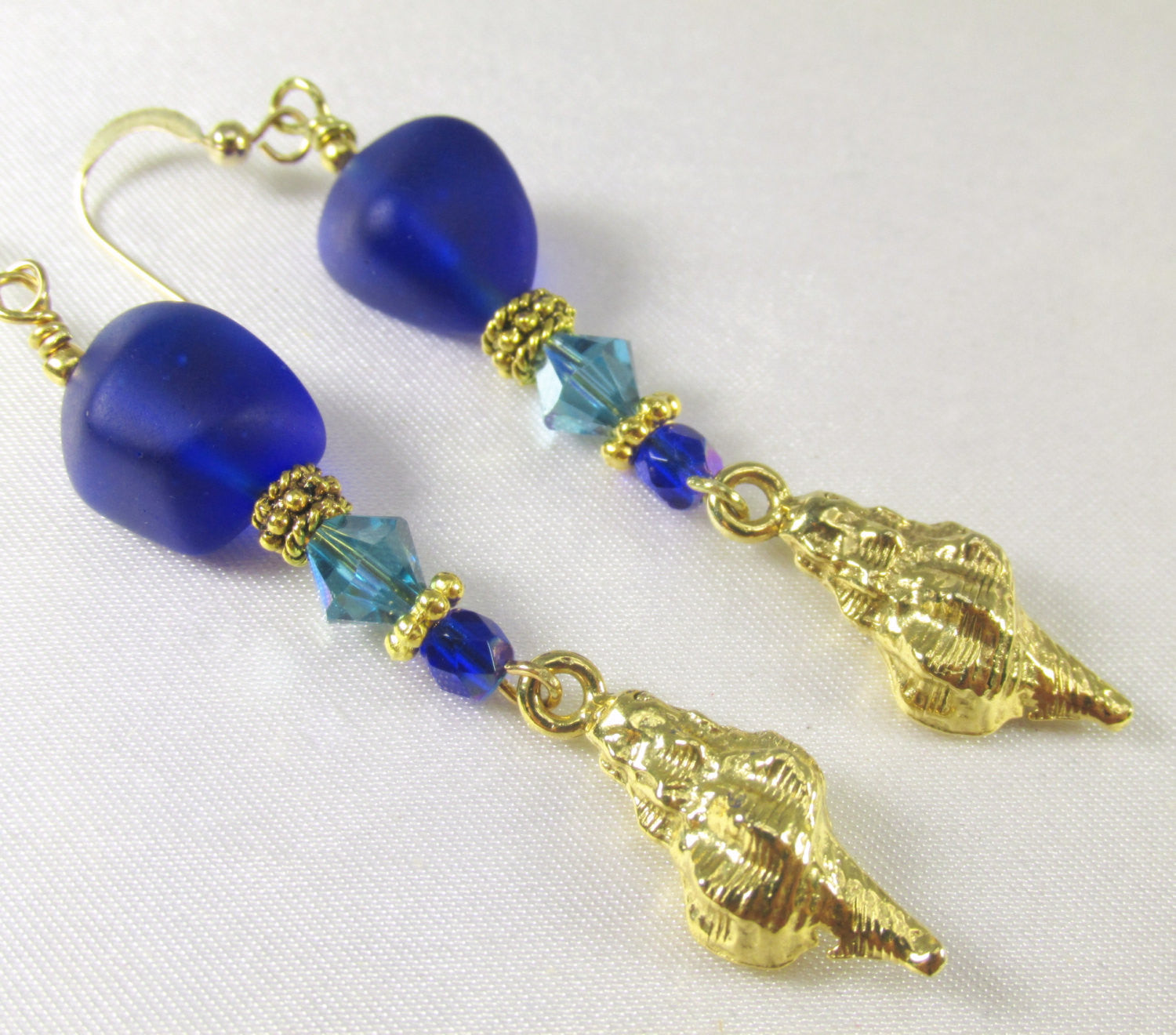 Long Beach Earrings with Royal Cobalt Blue Sea Glass, Turquoise Swarovski crystals, and Gold Concho Shell charms - Odyssey Creations