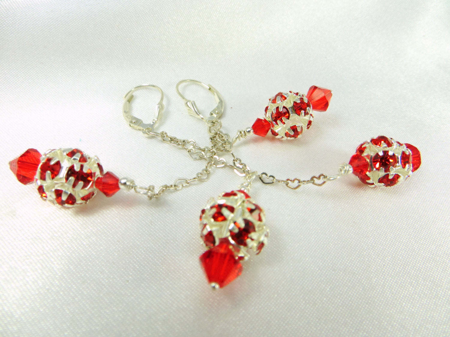 Dazzle Ball Red Swarovski on Heart on fine Sterling Silver chain and fine sterling silverleverbacks - Odyssey Creations