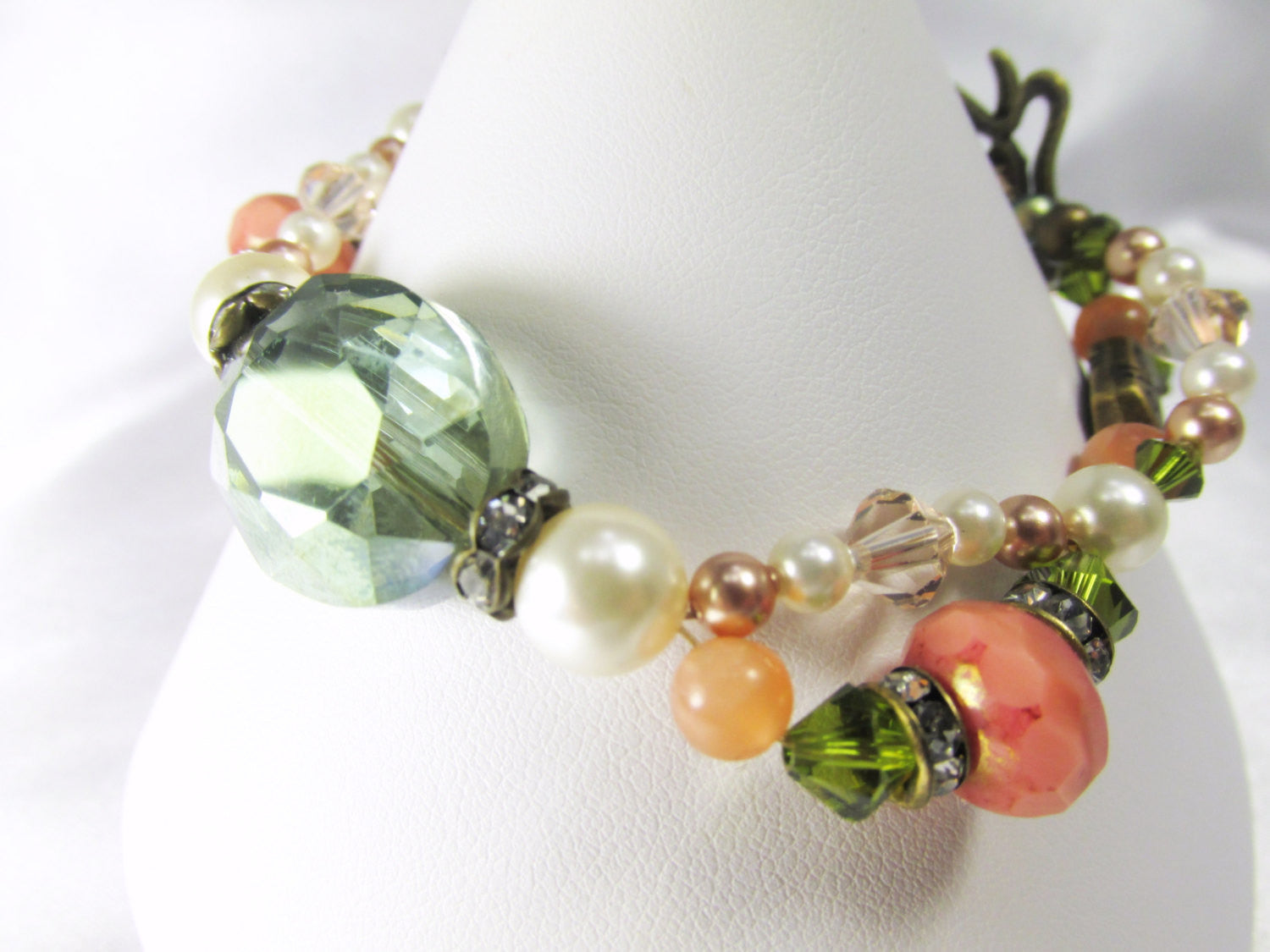 Antique Brass Bracelet in Olive Green Crystals, Coral Czech Rondelles, Moonstone gemstones, Swarovski Pearls and Crystals - Odyssey Creations