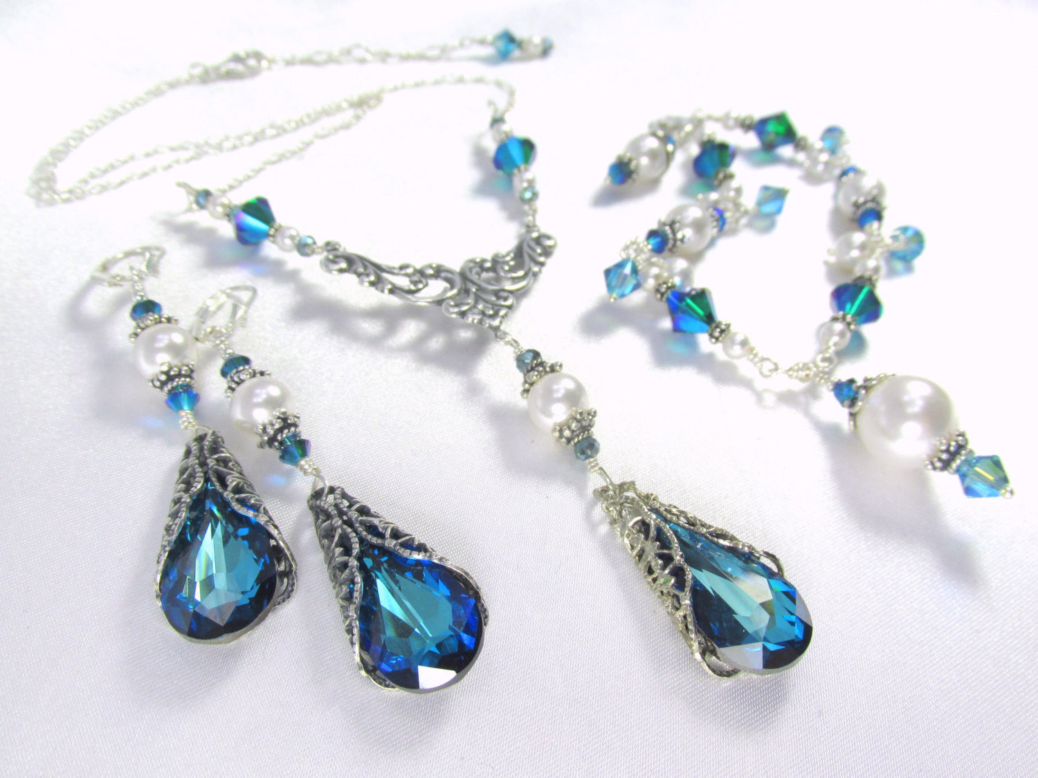 Statement Necklace with Filigree Wrapped Swarovski Bermuda Blue Turquoise Teardrop, Swarovski Pearls and Sterling Silver Chain - Odyssey Creations