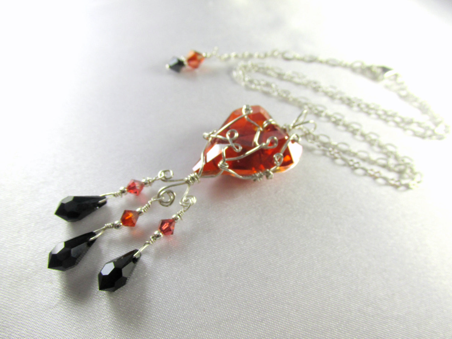 Swarovski Red Magma Wired Wild Heart Necklace in Sterling with Jet Black Teardrops - Odyssey Creations
