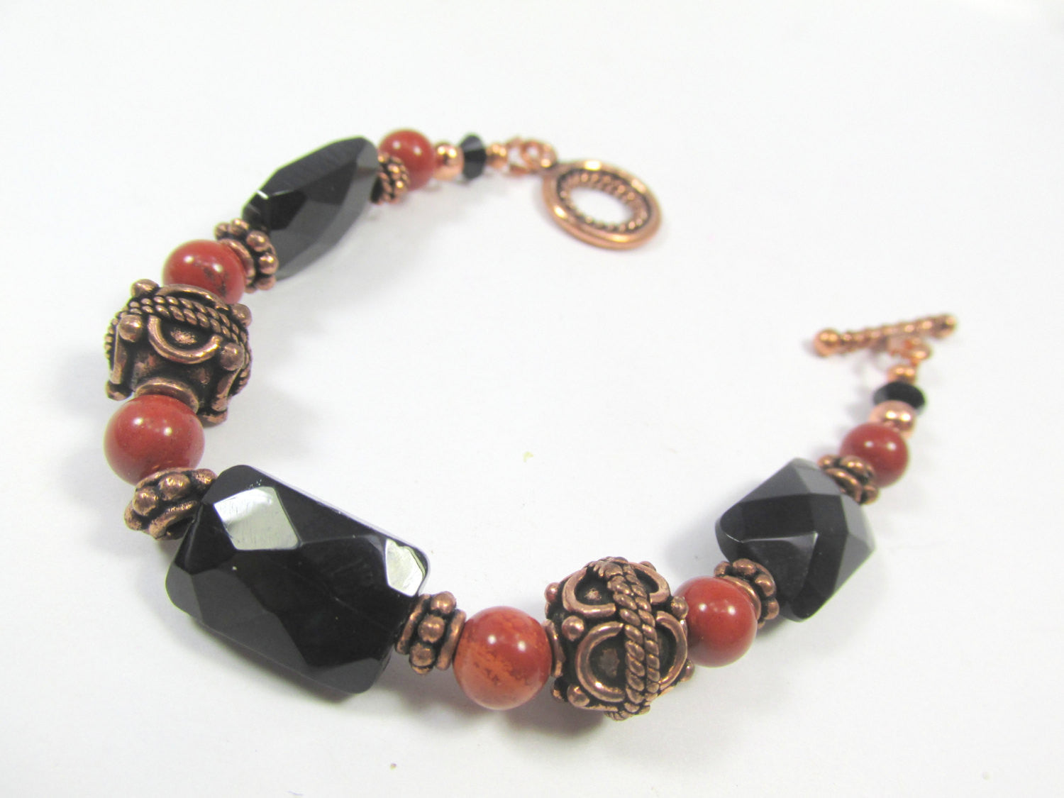 Red Jasper, Black Faceted Onyx and Bali Copper Toggle Clasp Small Bracelet - Odyssey Creations