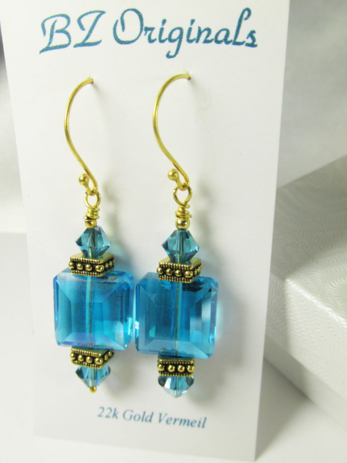 Blue Turquoise Faceted Cube Drops, with Antique Gold Tierra Caste Square Spacers and Swarovski Crystals on 22k Gold Vermeil Wires - Odyssey Creations