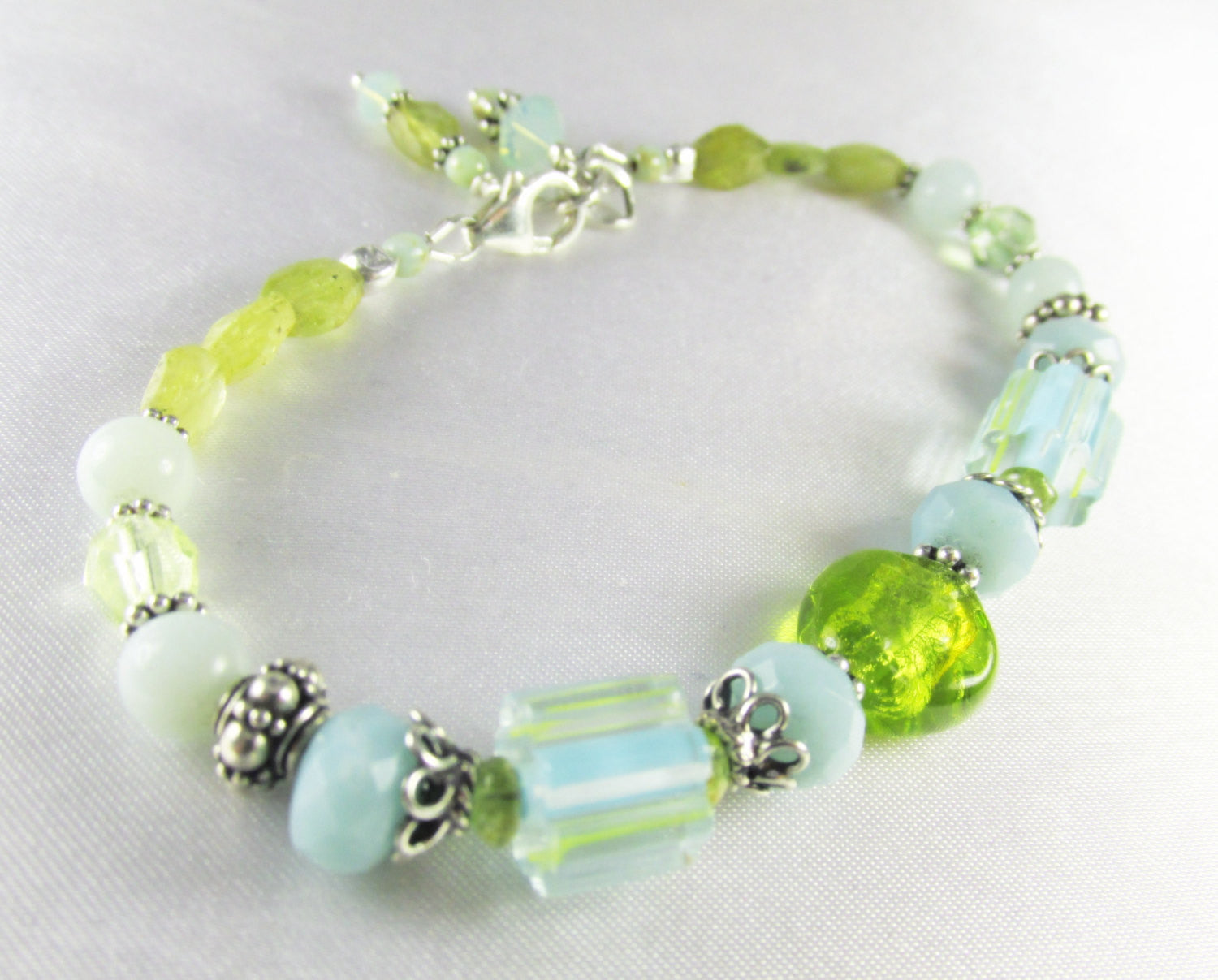 Aqua and Green Charm Bracelet with Amazonite & Peridot gemstones Murano and Cane Glass Lampwork beads and all sterling silver - Odyssey Creations
