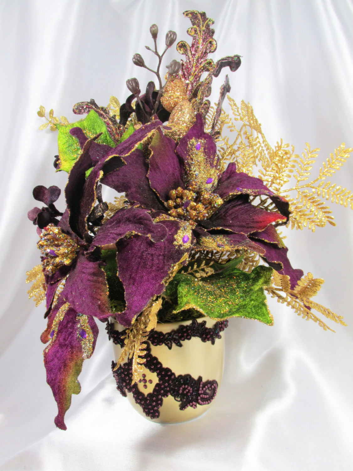 Christmas Silk Floral Arrangement with dark Purple Poinsettias, Orchid, ferns & gold glittered accents, gold vase with pearl beaded accents - Odyssey Creations