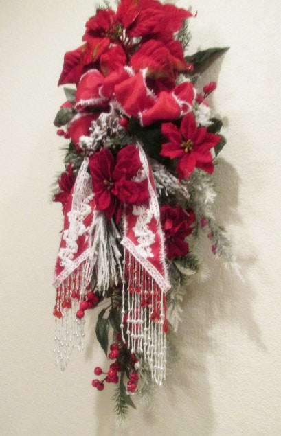 Victorian Vertical Christmas Door Swag in Traditional Red and White Poinsettia with Snowy Evergreens and Beaded Fringe Trimmed Bow - Odyssey Creations