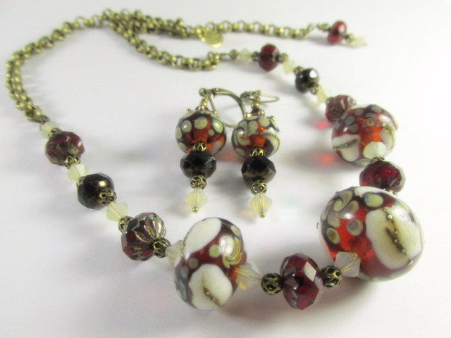 Lampwork Necklace and Earring Set in Marsala Red with Czech Beads, Swarovski Crystal Accents with adjustable closure in Brass - Odyssey Creations