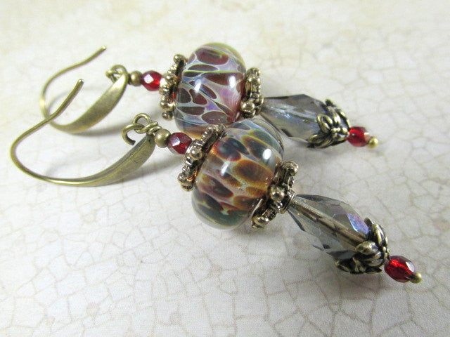 Smoky Blue and Marsala Red Lampwork Glass Earrings with Brass beadcaps and findings on fishhook wires or leverbacks - Odyssey Creations