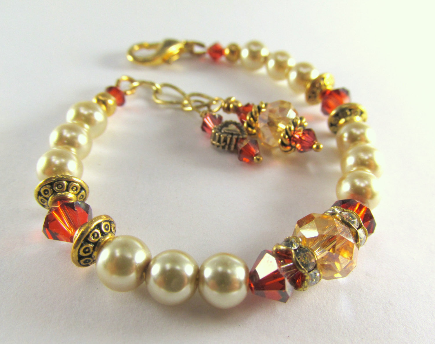 Small 6 Inch Bracelet in Light Gold Pearls and Swarovski Dark Red Magma Crystals - Odyssey Creations