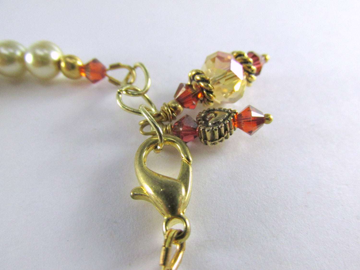 Child Size Very Small 6 Inch Bracelet in Light Gold Pearls and Swarovski Dark Red Magma Crystals - Odyssey Creations