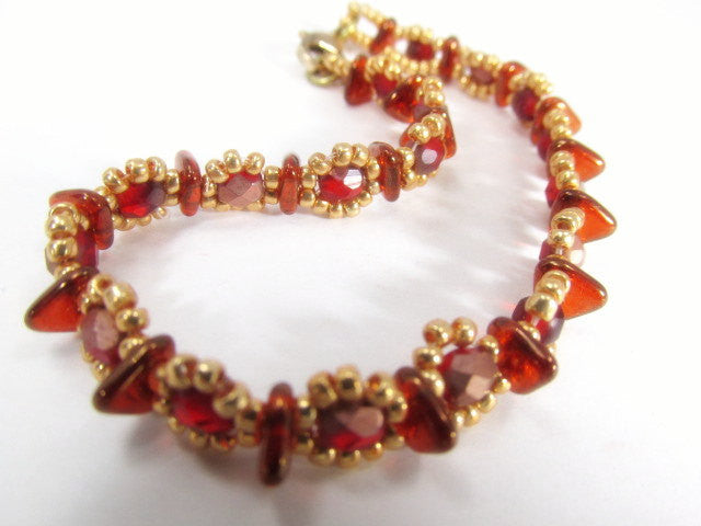 Red and Gold Beaded Bracelet handmade with Czech Glass Triangles, 4mm fire polished beads and gold seed beads - Odyssey Creations