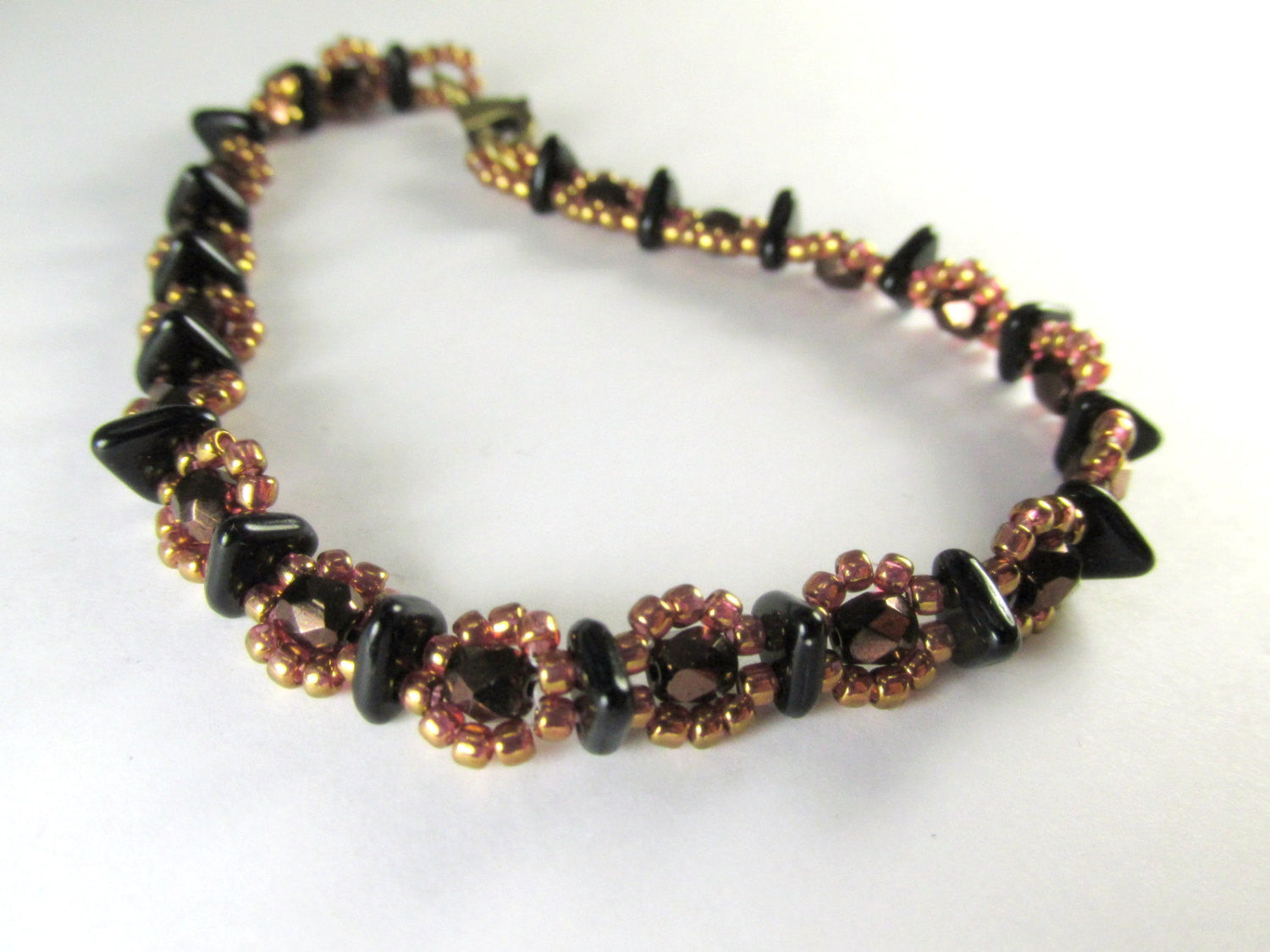 Black, Bronze and Rose Gold Beaded Bracelet handmade with Czech Glass Triangles, 4mm fire polished beads and bronze rosegold seed beads - Odyssey Creations