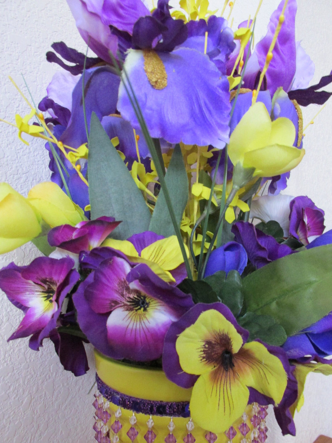 Spring Floral Centerpiece in Purple Iris, Yellow Forsythia, and Mixed Pansies and Tulips - Odyssey Creations