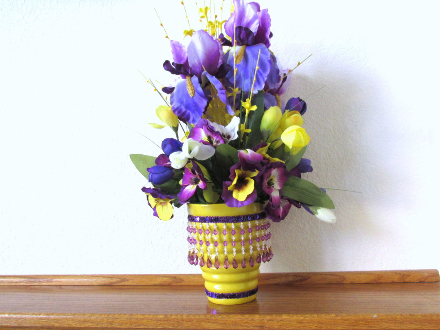 Awesome Spring Floral Centerpiece In Purple Iris Yellow Forsythia And Mixed Pansies And Tulips Download Free Architecture Designs Estepponolmadebymaigaardcom
