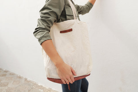 GIRL WITH REUSABLE COTTON AND LEATHER SHOPPING TOTE