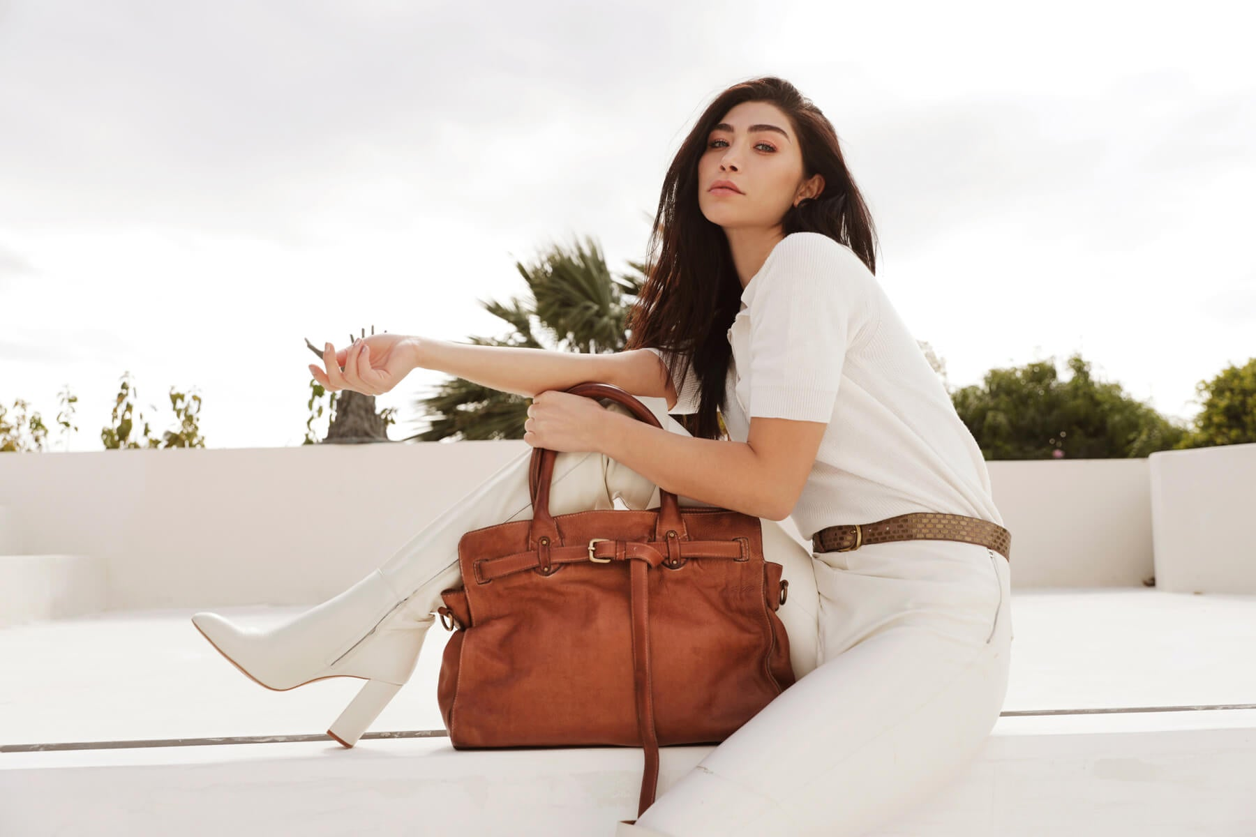 Woman holding a camel leather bag