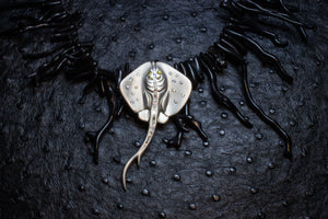 Manta ray pendant on black coral necklace