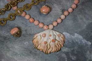 Shell pendant on pink Coral bead necklace