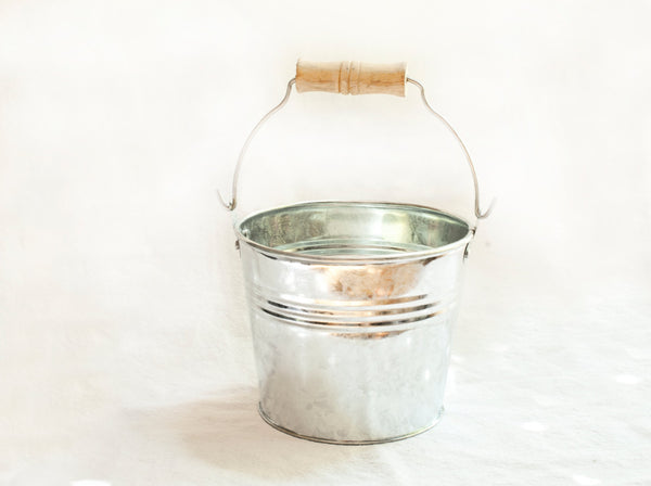small metal buckets for flowers at wedding image