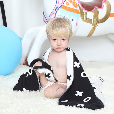 Reversible Knitted Blanket - XO for baby, toddler and kids for nursery and bedroom. Nordic style decor throw