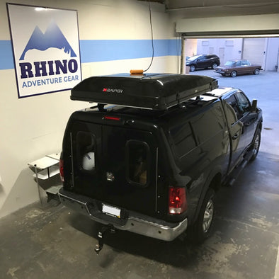 black Ram 2500 truck at Rhino Adventure Gear Showroom with camper topper and newly installed Rhino Rack Roof Rack and iKamper Skycamp Roof Top Tent