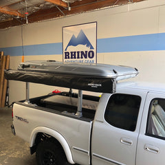 toyota tundra pickup with grey james baroud evasion xxl roof top tent and rhino rack batwing awning installed on thule xsporter bedrack in San Francisco CA