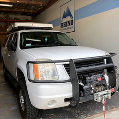 GMC Suburban Rhino Rack Crossbars and iKamper Skycamp installation at Rhino Adventure Gear