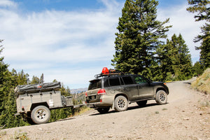 200 Series Land Cruiser and Off Road Trailer from Rhino Adventure Gear seen climbing mountain on dirt road