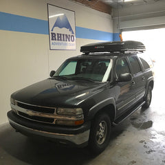 Chevy Suburban with Rhino Rack Vortex bars and iKamper installed at Rhino Adventure Gear Showroom