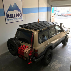 custom 80 series land cruiser with newly installed Rhino Rack Pioneer Platform Rack System shown in Rhino Adventure Gear Showroom in SF, CA