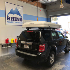 ford escape SUV with Rhino Rack Roof Rack and iKamper Roof Top Tent installed at Rhino Adventure Gear in California