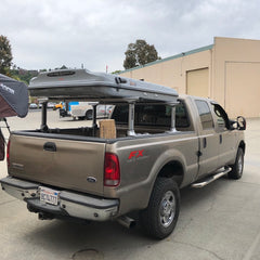 Ford F250 with Thule Xsporter Bed Rack System and James Baroud Evasion Roof Top Tent installed at Rhino Adventure Gear in California