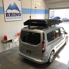Ford Transit with iKamper Skycamp Roof Top Tent installed at Rhino Adventure Gear in California