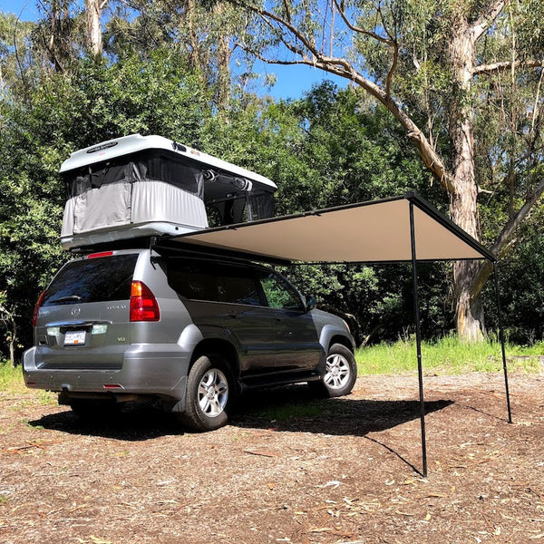 Overland vehicle outfitted with James Baroud Evasion Evo Roof Top Tent and Side Awning combined setup