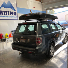 Honda Pilot with Custom Rhino Rack Roof Rack System and black iKamper Skycamp Roof Top Tent installed at Rhino Adventure Gear in California