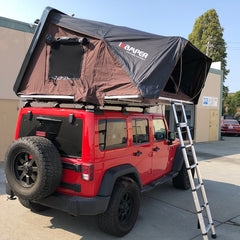 red Jeep JKU with iKamper roof top tent and Rhino Rack Backbone Vortex Quick Release Rack System