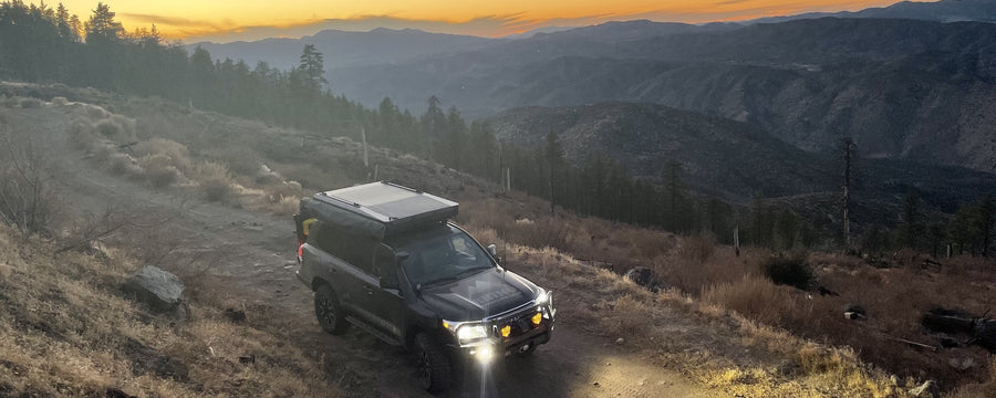 Overland Landcruiser with roof top tent exploring off road