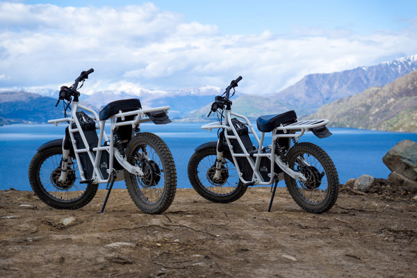 ubco 2x2 electric adventure bikes overlooking lake