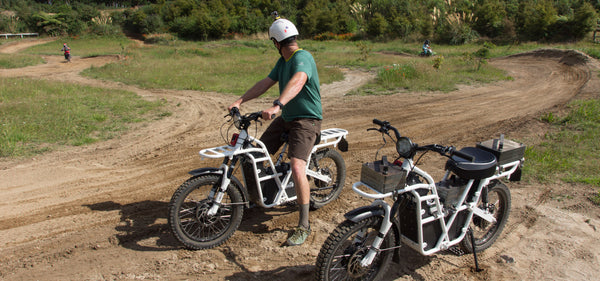 ubco 2x2 electric adventure bike on dirt bike course