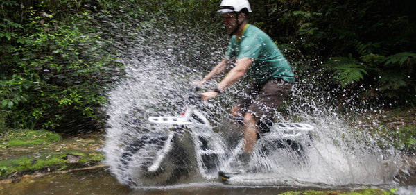 ubco 2x2 electric adventure bike riding through water