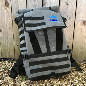 Grey waxed canvas adventure backpack with black trim and zipper and Rhino Adventure Gear embroidered logo