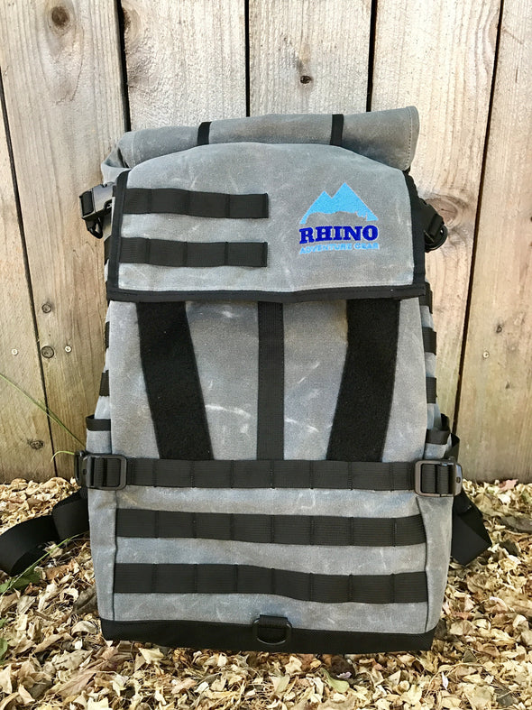 25L grey and black waxed canvas adventure backpack with blue embroidered Rhino Adventure Gear logo