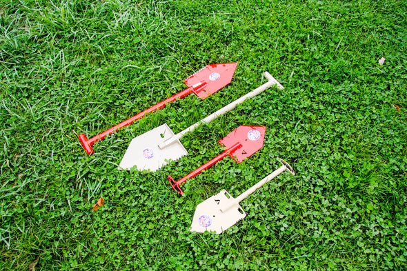 Shelterwerks MPS-1 and MPS-2T shovels laying in grass