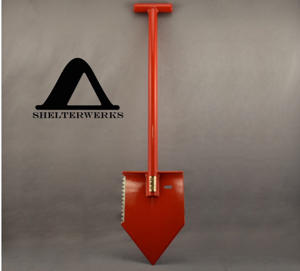 Shelterwerks MPS-1 red emergency shovel shown balancing on sharp tip of blade.